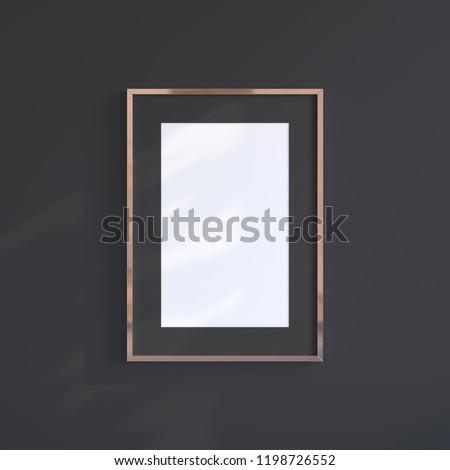 Copper blank frame on the black wall. Frame mock up.
