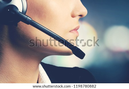 Woman Call Center operator on dark background #1198780882