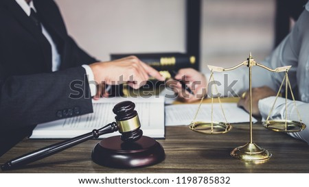 Businessman and Male lawyer or judge consult having team meeting with client, Law and Legal services concept. #1198785832
