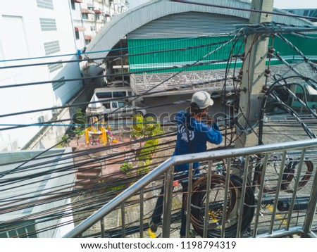 Pak Kret, Nonthaburi, Thailand. - On October 9, 2018 - electrician working. #1198794319