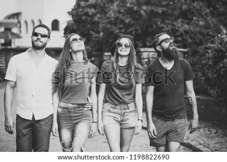 Group of friends walking on streets, urban style #1198822690