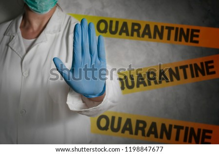 Health worker gesturing stop sign in quarantine.  Royalty-Free Stock Photo #1198847677