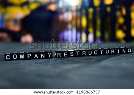 Company restructuring on wooden blocks. Business and finance concept. Cross processed image with bokeh background #1198866757