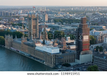 the london parliament with the bigben under construction and general view of the Thames River #1198915951