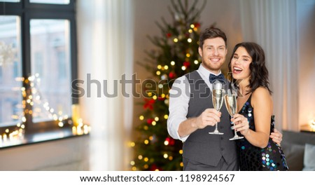 celebration and holidays concept - happy couple with glasses drinking non alcoholic champagne at party #1198924567