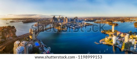 Over Lavender bay on Sydney harbour off Lower North Shore towards city CBD around the Sydney Harbour bridge , the rocks and Barangaroo. #1198999153