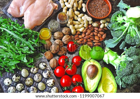 Ketogenic diet concept. A set of products of the low carb keto diet. Green vegetables, nuts, chicken fillet, flax seeds, quail eggs, cherry tomatoes. Healthy food concept. Keto diet food. #1199007067