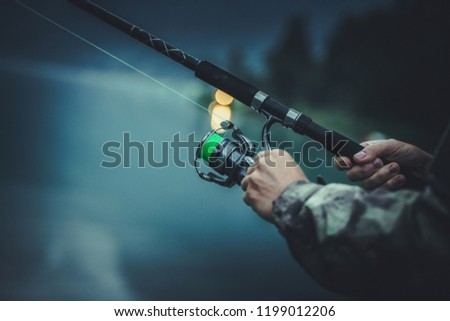 Late Fly Fishing. Angler with Fishing Rod in Hands. Closeup Photo. #1199012206