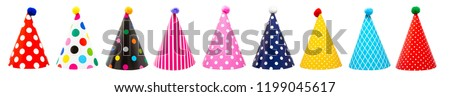 Row of nine colorful festive birthday party hats with different patterns and pom-poms #1199045617
