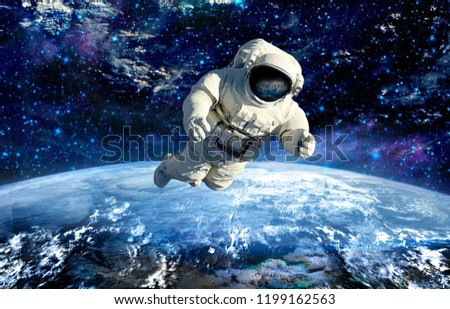 the astronaut on mission in outer space.elements of this image furnished by NASA #1199162563