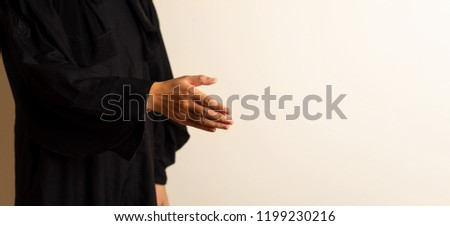 Muslim woman offering a handshake close up #1199230216