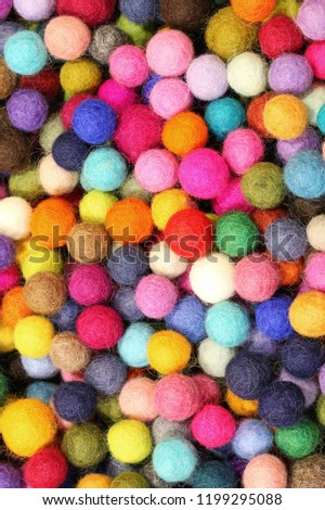background of thousand of colored little balls made with wool #1199295088