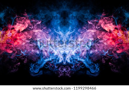 Thick colorful smoke of blue, pink and red  in the form of a skull, monster, dragon on a black isolated background. Background from the smoke of vape. Mocap for cool t-shirts