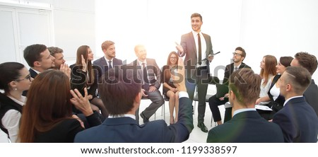 skilled coach asks questions to the participants of the training. Royalty-Free Stock Photo #1199338597