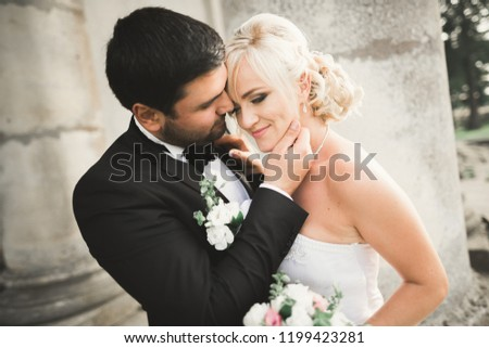Kissing wedding couple in spring nature close-up portrait #1199423281