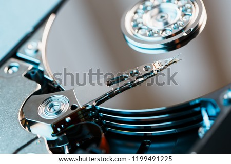 Disassembled hard drive from the computer, hdd with mirror effect. Opened hard drive from the computer hdd with mirror effects. Part of computer pc, laptop.