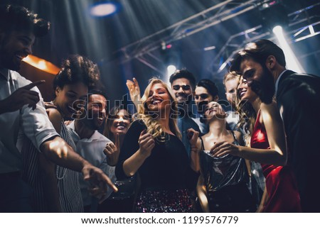 Shot of a young woman dancing in the nightclub Royalty-Free Stock Photo #1199576779