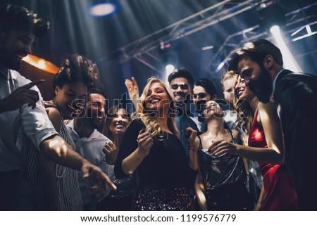 Shot of a young woman dancing in the nightclub #1199576779
