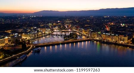 Aerial  night view of Geneva city waterfront skyline in Switzerland #1199597263