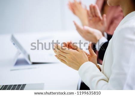 Businessman and business women clap their hands to congratulate the signing of an agreement or contract between their companies. concept of success, dealing, greeting and winning. #1199635810