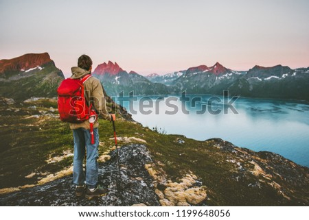Discoverer tourist man trekking in sunset mountains Traveling lifestyle adventure concept hiking with red backpack wanderlust vacations outdoor  #1199648056