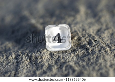 plastic translucent button number 4 from an old calculator on a concrete background, ,shallow dof #1199655406