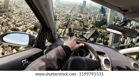 Driving a flying car to solve traffic problem, photo manipulation Royalty-Free Stock Photo #1199791531