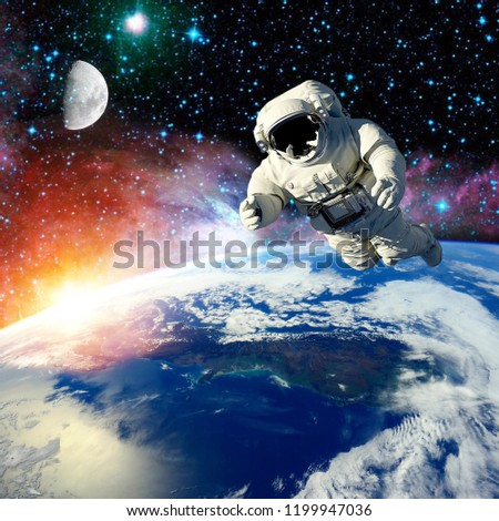 the mission in outer space astronaut.elements of this image furnished by NASA #1199947036