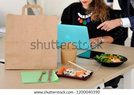 Anonymous delivery food service in the office - employees on lunch break order food to eat in the office during the work #1200040390