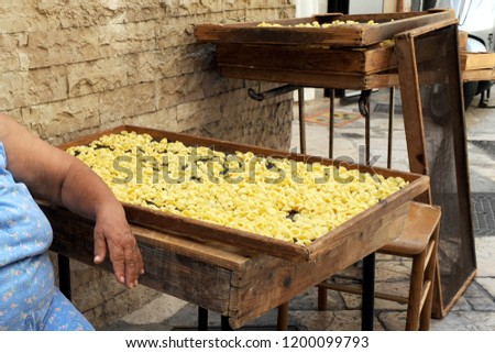 Bari , puglia ,  Italy south october 11,2018 - orecchiette pugliesi - typical italian handmade pasta #1200099793