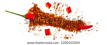 Chilli, red pepper flakes and chilli powder burst on white background. #1200103204