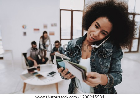 Colors for Design. Phone. Curly-Haired. Girl. Office. Samples of Colors. Paper Cup. Choose Men. Designers. Brainstorming. Design Studio. Multi-Ethnic. Project. Creative. Workplace. #1200215581