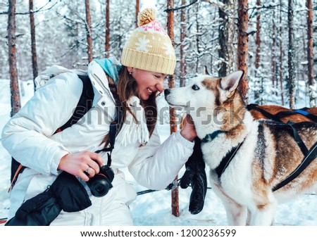 Girl and Husky dog in sled in Finland in Lapland in winter. #1200236599