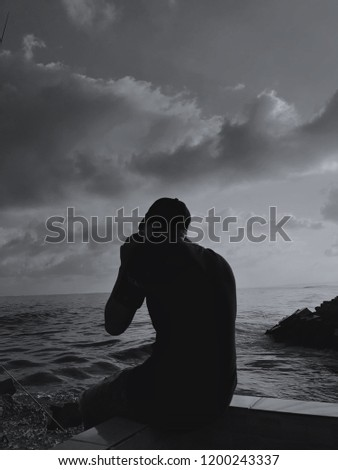 Silhouette guy next to the sea #1200243337