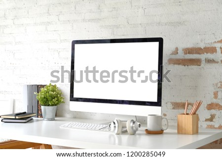 Loft workplace with mockup blank screen desktop computer and home office accessories #1200285049