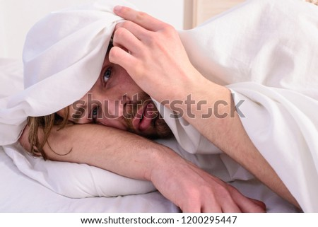 Fresh bedclothes concept. Man unshaven handsome relaxing bed. Let your body feel comfortable. Man sleepy drowsy unshaven bearded face covered with blanket having rest. Guy lay under white bedclothes. #1200295447
