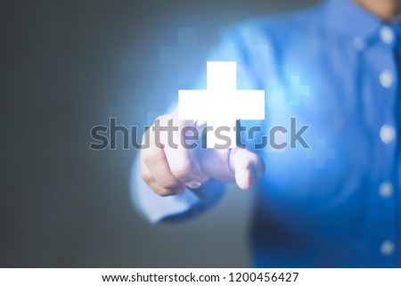 Businessman pushing button positive thing. Business for Profit, Benefit, Development and growth Concepts. Represented by a plus sign #1200456427
