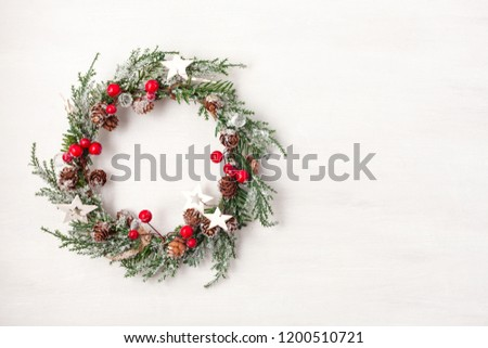 Top view of traditional Christmas wreath with copy space. Winter holidays and Christmas celebration concept #1200510721