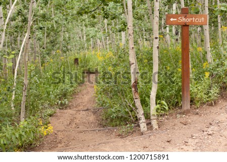 Shortcut sign on a hike Royalty-Free Stock Photo #1200715891