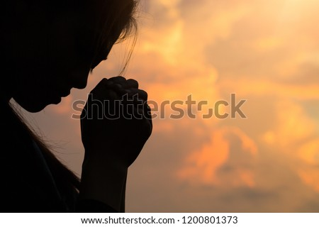 Silhouette of woman hands praying to god with the bible. Woman Pray for god blessing to wishing have a better life. Christian life crisis prayer to god. #1200801373