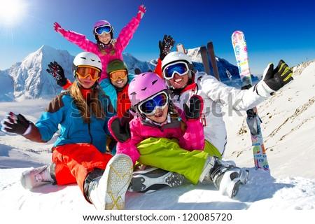 Skiing, winter, snow, sun and fun - family enjoying winter vacations