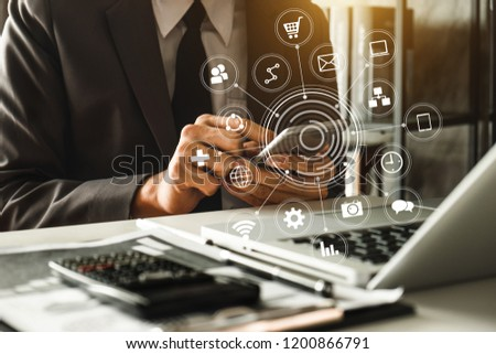 Businessman hand using laptop, tablet and smartphone  in office. Digital marketing media mobile app in virtual icon screen #1200866791