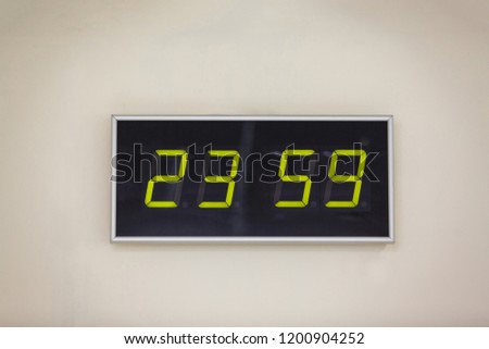 Black digital clock on a white background showing time 23.59 minutes #1200904252