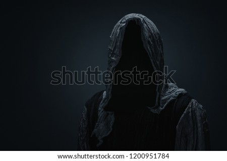 Silhouette of a death over dark gray background with copy space  #1200951784