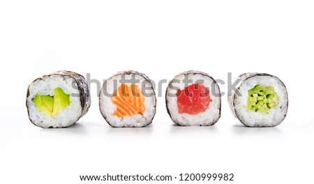 Four maki rolls in a row with salmon, avocado, tuna and cucumber isolated on white background. Fresh hosomaki pieces with rice and nori. Closeup of delicious japanese food with sushi roll. #1200999982