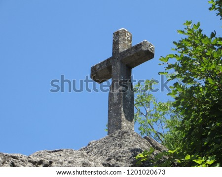 Stone cross on top of the Pic Saint-Loup South of France