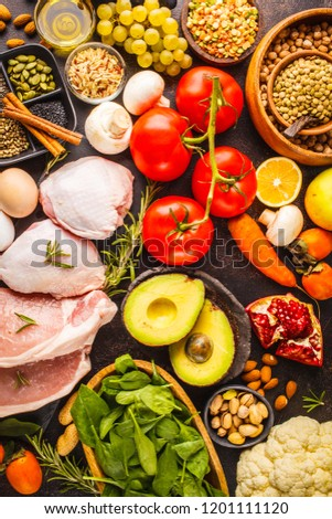 Balanced diet food background. Healthy ingredients: fruits, vegetables, meat, cereals and nuts on a dark background, top view. #1201111120