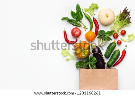 Shopping vegetarian food supermarket concept. Healthy vegetables in paper bag on white background, top view, copy space #1201168261