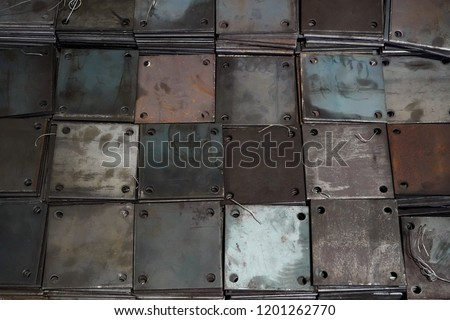 Stack of metal plate in factory warehouse, steel texture background.