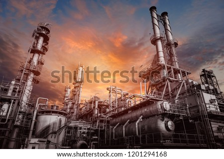 Industrial furnace and heat exchanger cracking hydrocarbons in factory on sky sunset background, Close up of equipment in petrochemical plant #1201294168